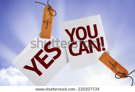 Yes You Can on Paper Note on sky background - stock photo