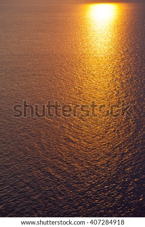 yewoll sunset or sunrise over a wide body of water - ocean , sea or lake. - stock photo