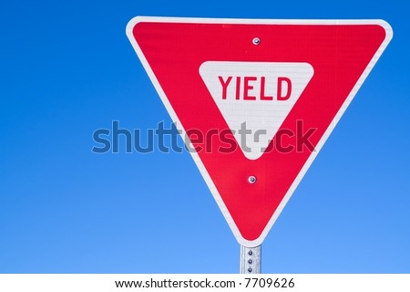 Yield sign positioned to leave room for writing on left