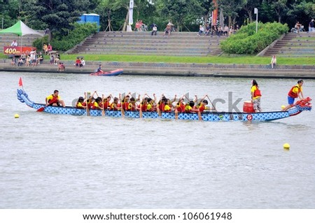 YILAN TAIWAN - JUNE 24:  Flag fetcher is ready to snatch the flag. The Dragon Boat Festival  on the Dongshan River on June 24, 2012 in Yilan - stock photo