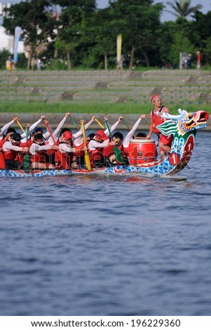 YILAN TAIWAN - JUNE 2: Rowers row their boat. The Dragon Boat Festival on the Dongshan River on June 2, 2014 in Yilan - stock photo