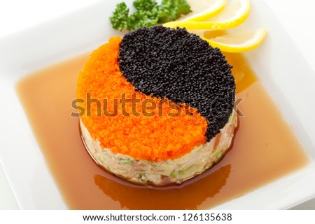 Yin-Yang Salad with Seafood and Avocado - stock photo