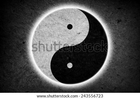 Yin Yang sign on papery background