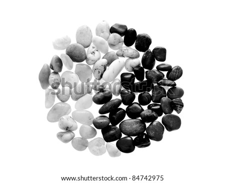 Yin Yang symbol made from beach pebble, isolated on white - stock photo