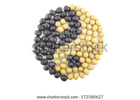 Yin-Yang symbol made from black and green olives isolated on white background