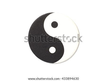 Yin-Yang symbol made of paper top view on white background