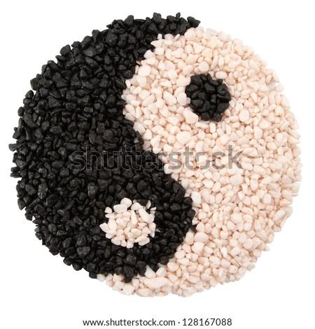 Yin-yang symbol of harmony and balance from little stones - stock photo