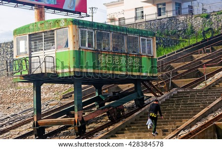YINXINGTUO, CHINA â?? April 15, 2016: Cabin elevator on a Yangtze river harbor in Yinxingtuo, China. These typical Chinese cabin elevators are placed at most bigger harbors along the Yangtze river.  - stock photo