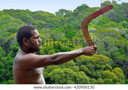 Yirrganydji Aboriginal warrior throw boomerang during cultural show in Queensland, Australia. - stock photo