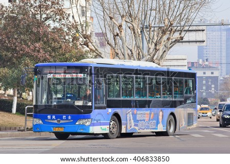 YIWU-CHINA-JAN. 26, 2016. Bus with an advert. Outdoor ads are flexible alternatives to China's rigid state-run television market. Last year marketers spend $2.5 billion on outdoor advertising in China - stock photo