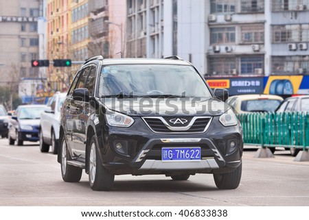 YIWU-CHINA-JAN. 26, 2016. Chery Tiggo SUV. While western car brands faces dramatic sales drops in China, local brands shows robust growth. Chinese car maker Chery reported 17% rise in sales in 2015.  - stock photo