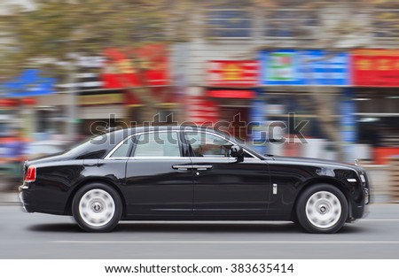 YIWU-CHINA-JAN. 20, 2016. Rolls-Royce Ghost. Rolls Royce sales dropped 54% as luxury products in China have been hit by economic woes and the authority efforts to stamp out bribery and corruption. - stock photo