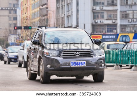 YIWU-CHINA-JAN. 26, 2016. Toyota Highlander SUV. Japan's biggest automaker by volume sold a total of 1.12 million vehicles last year, up 8.7 percent from a year earlier, outpacing the overall market. - stock photo