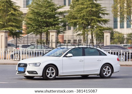 YIWU-CHINA-JAN. 26, 2016. White Audi A4 sedan. China alone forms almost one-third of Audi's sales volume, and the German car-maker holds the dominant position in the country's premium vehicle market.