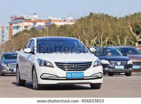 YIWU-CHINA-JAN. 25, 2016. White Hyundai Sonata. Hyundai and its affiliate Kia, which aims sell over 8 million cars in the global market, have been hit by the China shock since the beginning of 2016.