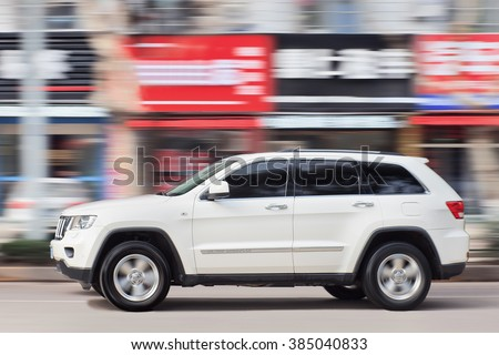 YIWU-CHINA-JAN. 19, 2016. White Jeep Cherokee. Jeep sticks to its plan to expand production in China with two more sport utility vehicles locally built this year amid market turmoil in the country.