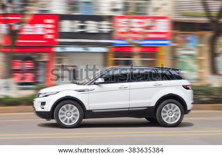 YIWU-CHINA-JAN. 20, 2016. White Range Rover. Jaguar Land Rover's sales have soared 23% in the UK, 35% in the rest of Europe and 28% in North America. But in China they are down 28% so far in 2016. - stock photo