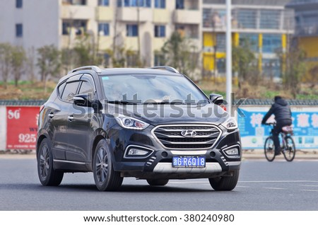 YIWU-CHINA-JANUARY 26, 2016. Black Hyundai IX 35 SUV on the street. Hyundai car sales in China increased 11.2 percent in 2015, keeping an upward trend for the succeeded South Korea's top car-maker. - stock photo