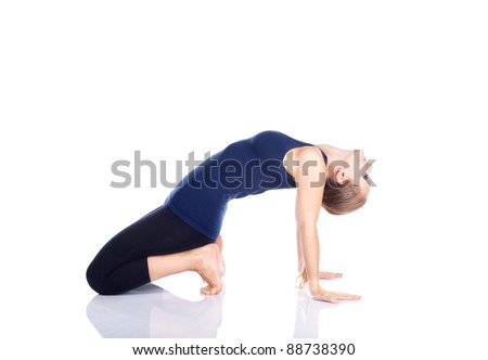 Yoga backward bending pose by beautiful Caucasian woman in blue Capri and top at white background. Free space for text - stock photo