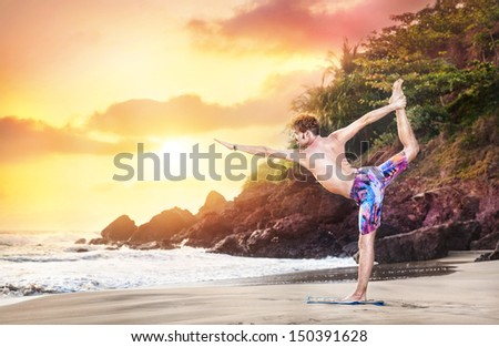 Yoga by man on the beach near the ocean at sunset in India - stock photo
