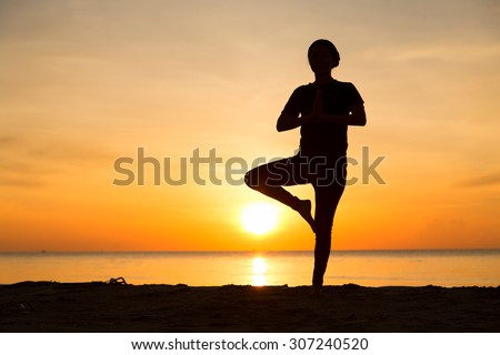 Yoga by the Sea - stock photo