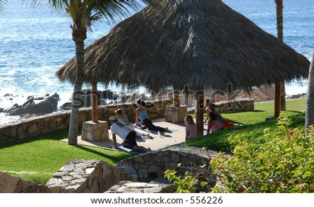 Yoga by the sea in Mexico - stock photo