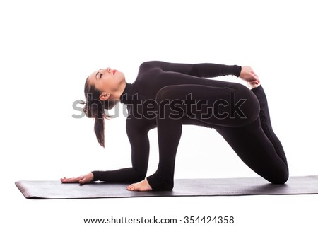 Yoga concept: young beautiful yoga female posing on a studio background - stock photo