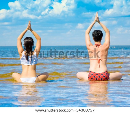 yoga for two - stock photo