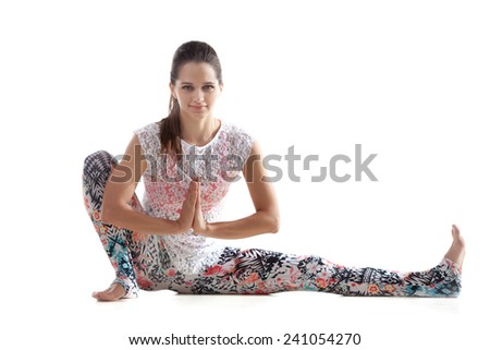 Yoga girl on white background exercises with palms in namaste gesture - stock photo