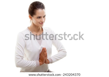 Yoga girl on white background with palms touching in a gesture of Namaste with space for text - stock photo