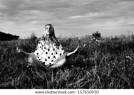 Yoga girl or Meditating - stock photo