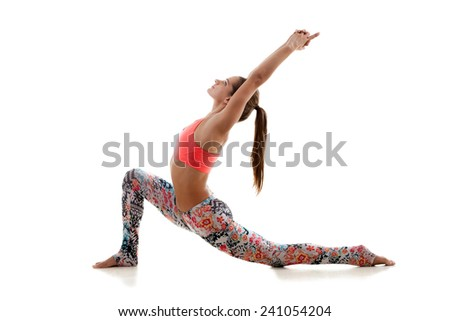 Yoga girl practices in colorful sportswear with stretched up arms on white background - stock photo