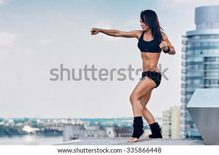 Yoga in a modern urban city. Young attractive girl - yoga against modern skyscrapers - stock photo
