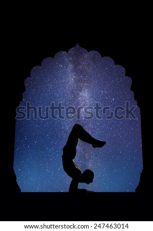 Yoga in old temple at night sky with Milky Way and stars - stock photo