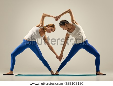 yoga in pair. heart - stock photo