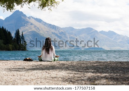 yoga in the nature in mountain scenery - stock photo