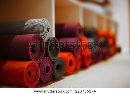 yoga mats in yoga club - stock photo