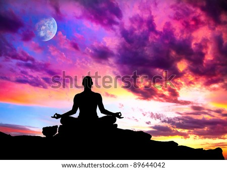Yoga meditation in lotus pose by man silhouette with moon and purple dramatic sunset sky background. Free space for text and can be used as template for web-site - stock photo