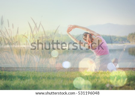 Yoga, Morning the Asia women beautiful model health care show yoga healthy slender is smile on the garden . shirts is pink, background is overlay women with grass and sunset, bokeh
