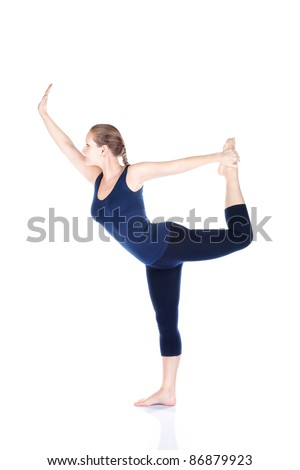 Yoga natarajasana dancer balancing pose by beautiful Caucasian woman in blue Capri and top at white background. Free space for text - stock photo