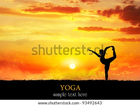 Yoga Natarajasana dancer balancing pose by Man in silhouette with dramatic sunset sky background. Free space for text - stock photo