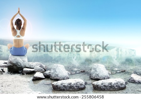 yoga on coast yoga time  - stock photo