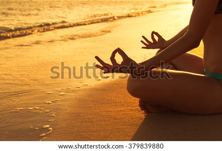 Yoga on the beach.  - stock photo