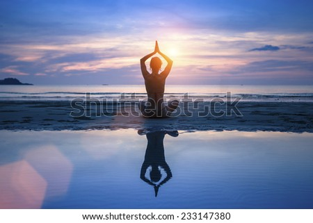 Yoga on the sea beach, meditation. - stock photo