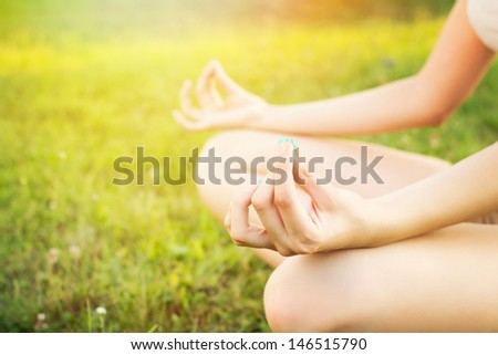 Yoga outdoors - stock photo