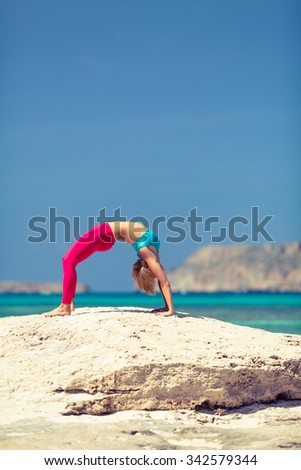 Yoga pose, fit woman stretch and exercise on a beach and mountains. Motivation exercising and inspirational beautiful landscape. Healthy lifestyle outdoors in nature, fitness concept. - stock photo