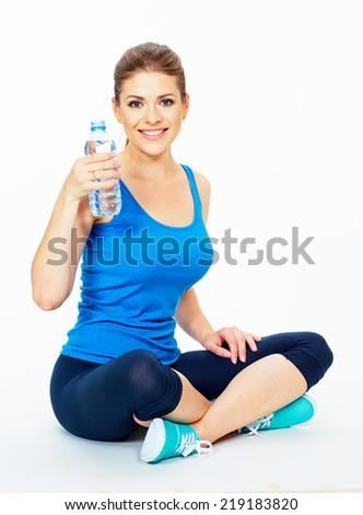 yoga pose . woman holding bottle of water . white background isolated . - stock photo