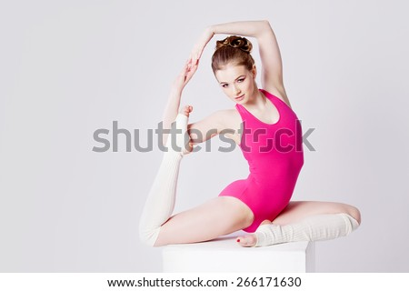 yoga poses, sport girl in pink gymnastics leotard, horizontally - stock photo