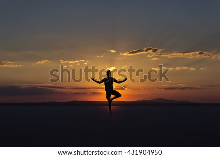 Yoga posture on sunset by man