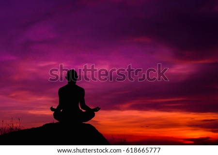 Yoga practicioner during the sunset meditation.Copy space for add text.